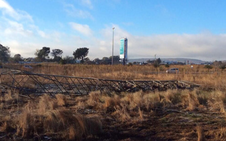 Mangled pylon on the burnt grass in Lenasia on 6 June 2014. Picture: Faizel Patel via Twitter.