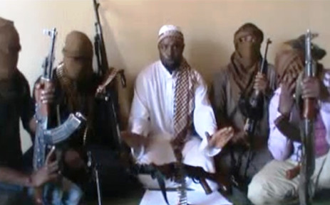 FILE:A screengrab taken from a video released on You Tube on April 12, 2012 apparently shows Boko Haram leader Abubakar Shekau (C) sitting flanked by militants.Picture:AFP.