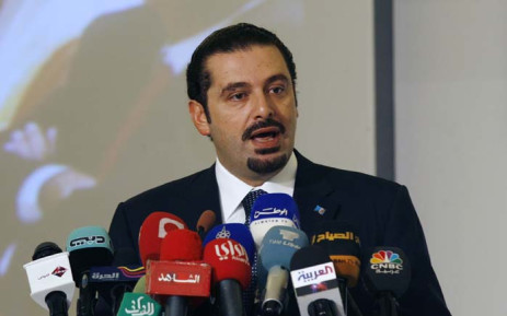 """FILE: Former Lebanese Prime Minister Saad al-Hariri gives a speech during the opening ceremony of the second """"Kuwait Financial Forum"""" in Kuwait City on 31 October 2010. Picture: AFP"""