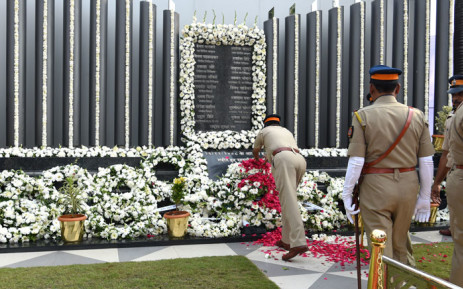 Members of the Mumbai Police pay their respects at the Police Memorial, during an event to commemorate the 10th anniversary of the 2008 Mumbai militant attacks in Mumbai on 26 November, 2018. Picture: AFP