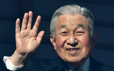 Japan's Emperor Akihito waves to well-wishers during New Year's greetings at the Imperial Palace in Tokyo on 2 January 2019. Picture: AFP