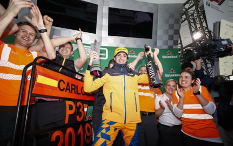 McLaren's Carlos Sainz celebrates his third-place finish at the Brazilian Grand Prix on 17 November 2019. Picture: @McLarenF1/Twitter