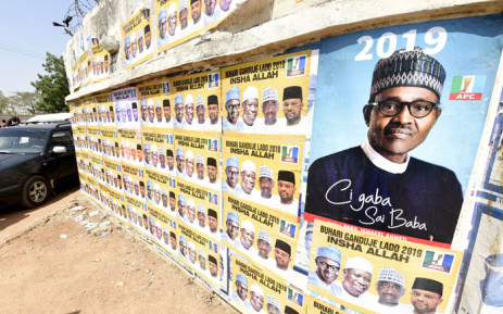 Placards with the ruling All Progressives Congress (APC), Nigerian President Mohammadu Buhari, are displayed during a campaign rally at the Sanni Abacha Stadium in Kano, on 31 January 2019. Picture: AFP