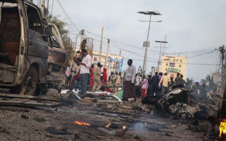 People gather at the scene of twin car bombs that exploded within moments of each other in the Somali capital Mogadishu on 9 November 2018. Picture: AFP