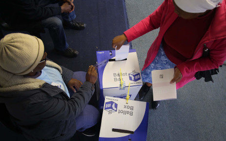A voter placing her marked ballots into the local and national ballot boxes on 8 May 2019. Picture: Bertram Malgas/EWN