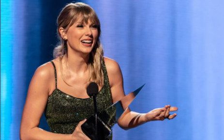 Taylor Swift accepting one of the six American Music Awards trophies she won on Sunday. Picture: Twitter/@AMAs
