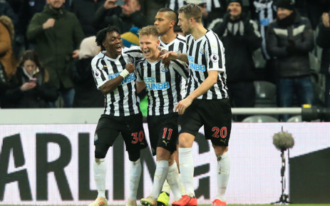 Newcastle players celebrate a goal against Manchester City in their English Premier League match on 29 January 2019. Picture: AFP