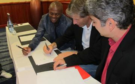 Thulani Serero signs for Ajax Amsterdam on 22 May 2011. Picture: Alicia Pillay/EWN