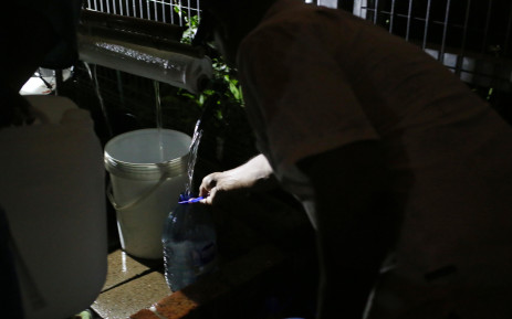 Water flows into a 5 litre container as Cape Town residents collect water before Day Zero. Picture: Bertram Malgas/EWN