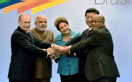 Russian President Vladimir Putin, India's PM Narendra Modi, Brazilian President Dilma Rousseff, China's President Xi Jinping and South Africa's Jacob Zuma gesture during the 6th BRICS Summit in Fortaleza, Brazil, on 15 July 2014. Picture: AFP.
