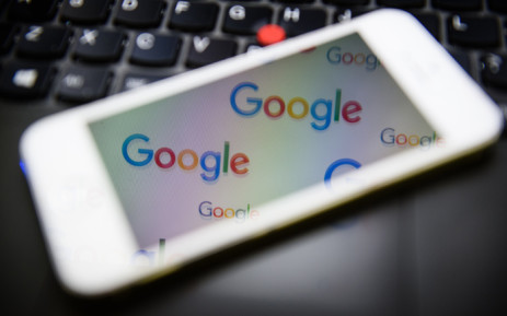 FILE: The logo for US technology company and search engine Google is displayed on screens in London on 11 February, 2016. Picture: AFP.