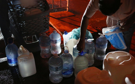 Cape Town residents fill up 5 litre containers throughout the night as they scramble to stock up before Day Zero. Picture: Bertram Malgas/EWN