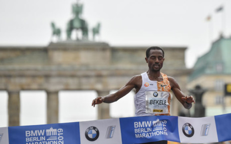 FILE: Ethiopia's Kenenisa Bekele crosses the finish line to win the Berlin Marathon on 29 September 2019 in Berlin. Picture: AFP