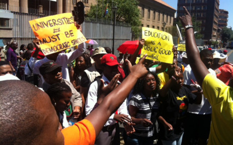 Students, parents and workers from the University of Johannesburg gather outside the court singing and dancing as they wait for missing dockets to be found, which will allow for court proceedings to eventually start on 9 November 2015. Picture: Kgothatso Mogale/EWN.