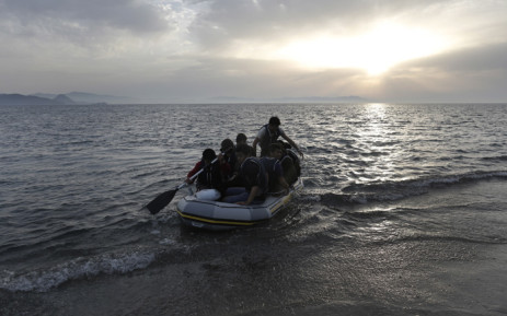 FILE: Refugees in a dinghy as they try to disembark at the coast off Kos island, near the sea border with Turkey, in Greece, in May 2015. Picture: EPA/Yannis Kolesidis.