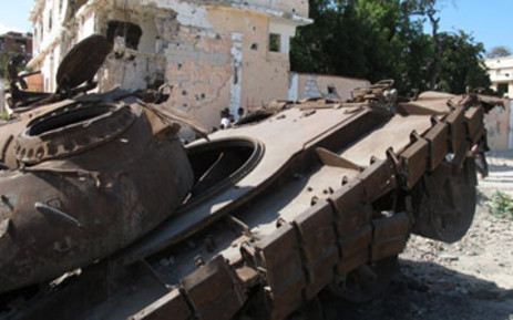 An African Union mission tank rusts in the middle of a road in Abdi Aziz district, a former Al-Shabaab stronghold, where some of the fiercest fighting took place. Photo: Nastasya Tay/EWN