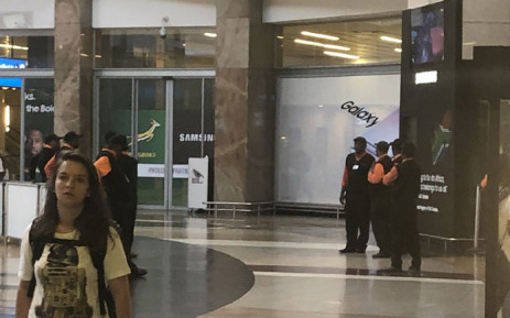 OR Tambo International Aiport porters (in background), who depend on tips for helping out passengers, said there was not much business as a result of SAA flights cancellation on 15 November 2019. Picture: Sifiso Zulu/EWN