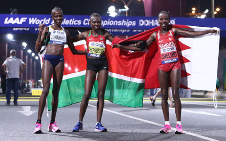 Kenya's Ruth Chepngetich (C) celebrates winning gold with Bahrain's Rose Chelimo (R) in silver and Namibia's Helalia Johannes in bronze after the Women's Marathon at the 2019 IAAF World Athletics Championships in Doha on 28 September 2019. Picture: AFP