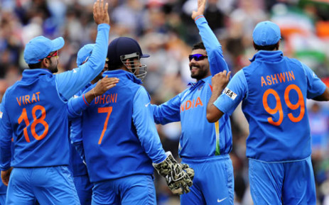 The Indian cricket team celebrate after a wicket fall during their Champions Trophy match against the West Indies. Picture: AFP