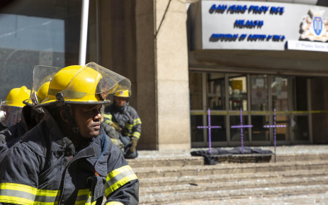 A firefighter sits in front of the Bank of Lisbon building where 3 of his colleagues died while trying to extinguish a fire.  Picture: Christa Eybers/EWN