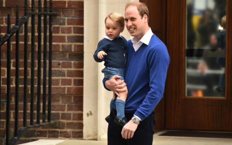 Britains Prince William, Duke of Cambridge (R), holds his son Prince George of Cambridge as they return to the Lindo Wing at St Mary's Hospital in central London, on 2 May, 2015 where his wife Catherine, Duchess of Cambridge, gave birth to their second child, a baby girl, earlier in the day. Picture: AFP.
