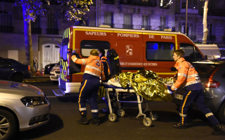 Rescuers evacuate an injured person on Boulevard des Filles du Calvaire, close to the Bataclan concert hall in central Paris, early on November 14, 2015. Picture: AFP