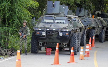 Colombian army tanks are seen on a national highway during a protest against a tax reform proposed by the Colombian government in the north of Santander, Colombia, on 4 May 2021. Picture: Schneyder Mendoza/AFP