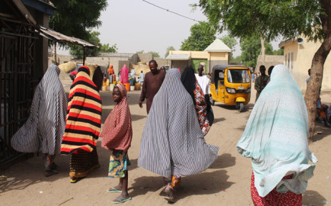 FILE: Residents are seen walking in Maiduguri, northeastern Nigeria on 7 April 2019, a day after a double suicide attack, that killed at least three people and wounded more than 30. At least three people were killed and more than 30 wounded in a double suicide attack in Maiduguri, the capital of northeastern Nigeria, ravaged by the insurgency of the jihadist group Boko Haram, according to security sources and residents on 7 April  2019. Picture: AFP