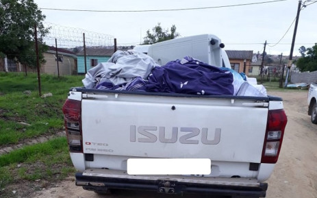 The vehicle of the four arrested suspects loaded with stolen goods. Picture: SAPoliceService/Facebook