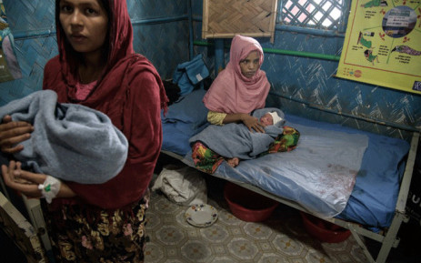 Rohingya refugees Zarina Begum (L), 20, and Latifa Begum (R), 30, hold their hours-old babies as they recover at an NGO-run maternity clinic in the Kutupalong refugee camp near Cox's Bazar. Picture: AFP.