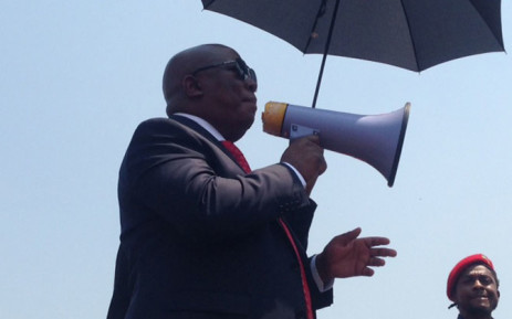 EFF leader Julius Malema addressing his supporters outside court in Polokwane on 30 September 2014. Picture: Vumani Mkhize/EWN.