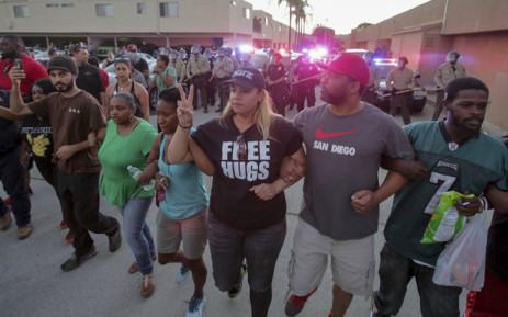 Protesters march through the street during a rally in El Cajon, a suburb of San Diego, California on 28 September, 2016, in response to the police shooting the night before. Picture: AFP.