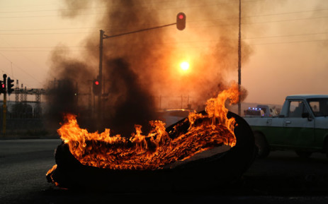 FILE: A tyre burns during a protest Picture: Christa Eybers/EWN
