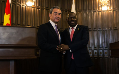 Chinese Foreign Affairs Minister Wang Yi (L) shakes hands with his Zimbabwean counterpart Sibusiso Moyo (R) after a joint press conference in the capital Harare 12 January 2019 during his visit to the country. Chinese Foreign Affairs Minister Wang Yi visits several African countries. Picture: AFP