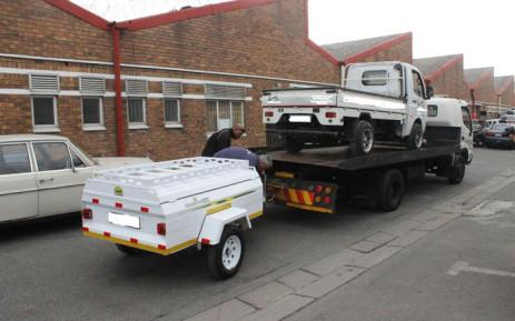 The NPA's Asset Forfeiture Unit seizes assets from a suspect. Picture: Xolani Koyana/EWN
