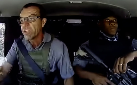 A YouTube screengrab of Leo Prinsloo (left) and Lloyd Mtombeni (right) taking evasive action after their cash-in-transit vehicle was attacked during an attempted heist in Pretoria. Picture: YouTube