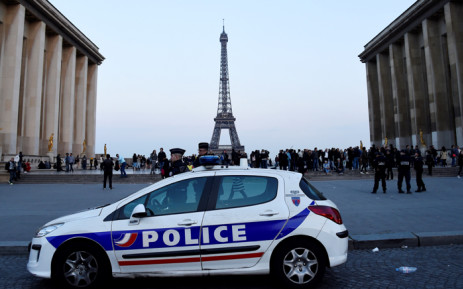 Policemen stand near a vehicle on the place du Trocadero in Paris on 21 April 2017 during a gathering in support to police. Picture: AFP.