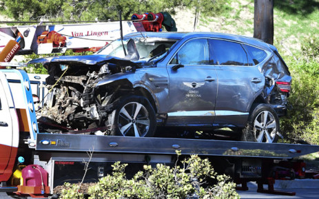 A tow truck recovers the vehicle driven by golfer Tiger Woods in Rancho Palos Verdes, California, on 23 February 2021, after a rollover accident. Picture: AFP