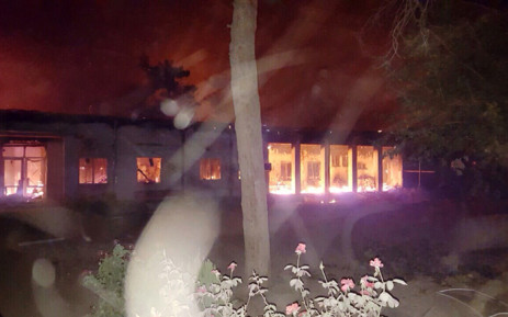 In this photograph released by Medecins Sans Frontieres (MSF) on 3 October, 2015, fires burn in part of the MSF hospital in the Afghan city of Kunduz after it was hit by an air strike. Picture: AFP.