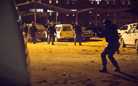 Police and the army raided the Madala hostel in Alexandra just before midnight on 22 April 2015. The move comes in a bid to quell xenophobic violence. Picture: Thomas Holder/EWN