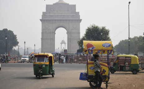 """An icecream vendor waits for customers under heavy smog near India Gate in New Delhi on 28 October 2019. Air quality in the Indian capital turned """"hazardous"""" on October 28 after a night of frenzied fireworks by revellers defying a Supreme Court ban to celebrate the Hindu festival of lights, Diwali. Picture: AFP"""