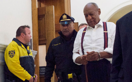 Comedian Bill Cosby is taken into custody in handcuffs at Montgomery County Courthouse 25 September, 2018 in Norristown, Pennsylvania, after being sentenced to at least three years in prison and branded a 'sexually violent predator' for assaulting a woman at his Philadelphia mansion 14 years ago. Picture: AFP