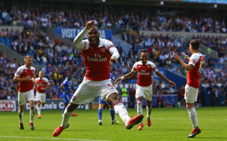 Arsenal's French striker Alexandre Lacazette (C) celebrates after playing the assist for their second goal scored by Arsenal's Gabonese striker Pierre-Emerick Aubameyang (2nd R) during the English Premier League football match between between Cardiff City and Arsenal at Cardiff City Stadium in Cardiff, south Wales on 2 September 2018. Picture: AFP.