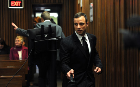 Murder accused Oscar Pistorius arrives at the High Court in Pretoria for his trial on 2 July 2014. Picture: Pool.