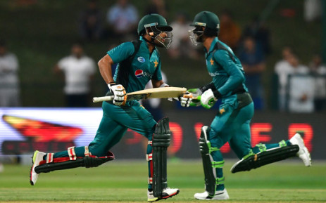 Pakistan cricketer Fakhar Zaman (R) and Pakistan cricketer Babar Azam run between the wickets during the second one day international (ODI) cricket match between Pakistan and New Zealand at The Sheikh Zayed Cricket Stadium in Abu Dhabi on 9 November 2018. Picture: AFP