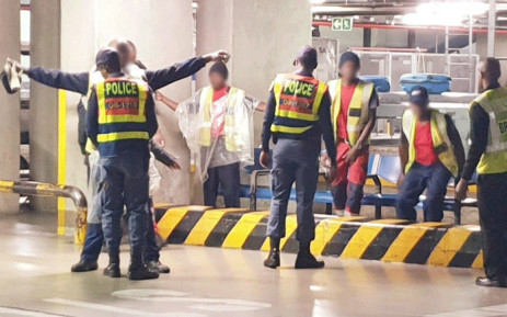 A random stop-and-search being carried out in one of the baggage handling areas at the OR Tambo International Airport. Picture: Supplied.