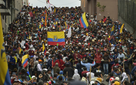 Protesters march against President Lenin Moreno's decision to slash fuel subsidies, in Quito on 9 October 2019. Picture: AFP
