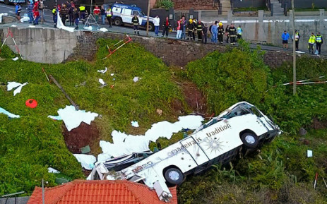 A video grab obtained from drone footage shows the wreckage of a tourist bus that crashed on 17 April 2019 in Canico, on the Portuguese island of Madeira. Picture: AFP