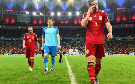 Spain's Andre Iniesta, Spain captain and goalkeeper Iker Casillas and Fernando Torres walk out of the field after they lost to Chile in the 2014 Fifa World Cup on 18 June 2014. Picture: Fifa.com.