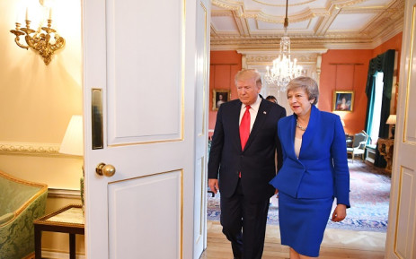 Britain's Prime Minister Theresa May (R) escorts US President Donald Trump through 10 Downing Street in London on 4 June 2019, on the second day of their three-day State Visit to the UK. Picture: AFP